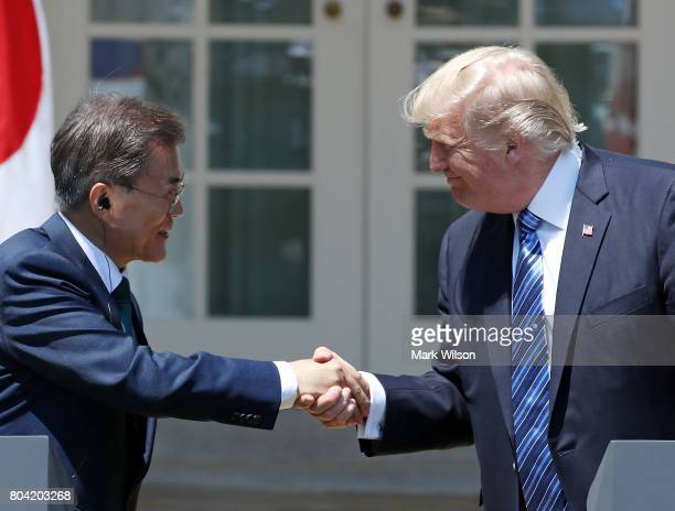 S President Donald Trump and South Korean President Moon Jaein shake hands while delivering joint statements in the Rose Garden of the White House on...
