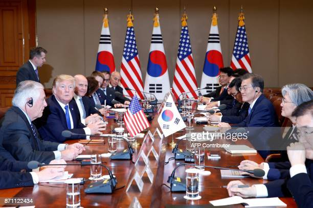 US President Donald Trump and South Korea's President Moon JaeIn hold a summit meeting at the presidential Blue House in Seoul on November 7 2017 US...