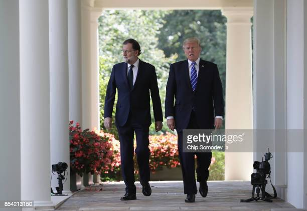 S President Donald Trump and Spanish Prime Minister Mariano Rajoy arrive for a joint news conference in the Rose Garden of the White House on...