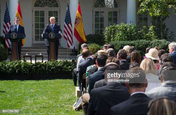US President Donald Trump and Spanish Prime Minister Mariano Rajoy hold a joint press conference in the Rose Garden of the White House in Washington...