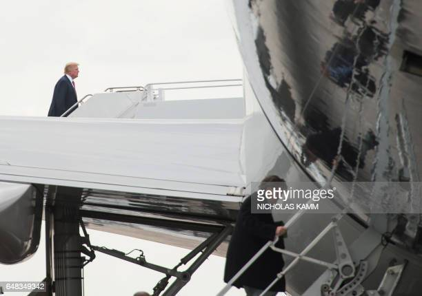 US President Donald Trump and top aide Steve Bannon board Air Force One at Palm Beach International Airport in West Palm Beach Florida on March 5...