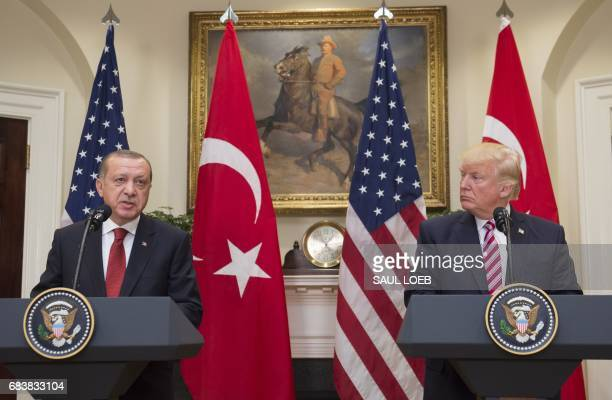 US President Donald Trump and Turkish President Recep Tayyip Erdogan speak to the press in the Roosevelt Room of the White House in Washington DC May...