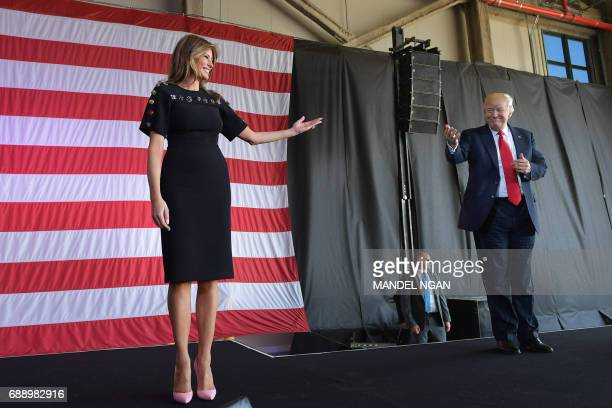 President Donald Trump and US First Lady Melania Trump address US military personnel and families at Naval Air Station Sigonella after G7 summit of...
