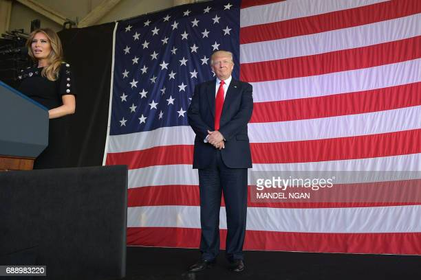 US President Donald Trump and US First Lady Melania Trump address US military personnel and families at Naval Air Station Sigonella after G7 summit...