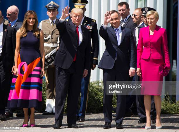 US President Donald Trump and US First Lady Melania Trump applaud next to Poland's President Andrzej Duda and Poland's first lady Agata...