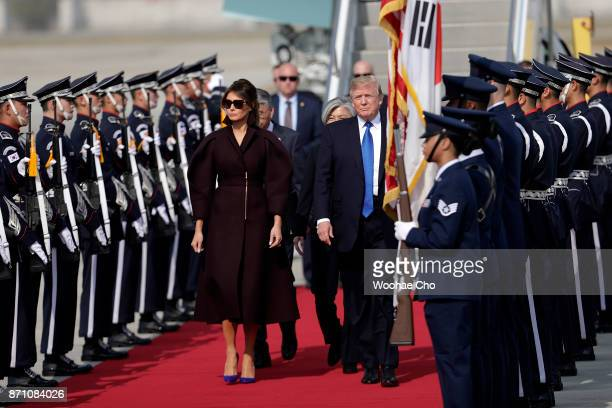 S President Donald Trump and US First Lady Melania Trump arrive at Osan Air Baseon November 7 2017 in Pyeongtaek South Korea Trump is in South Korea...