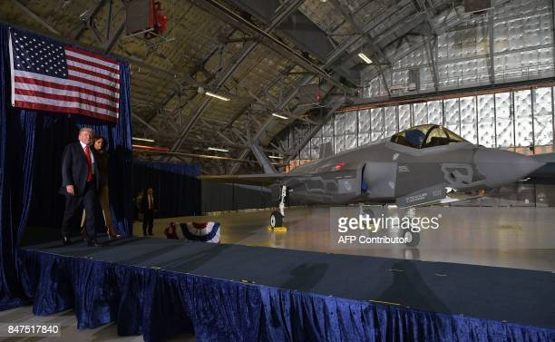 US President Donald Trump and US First Lady Melania Trump arrive to speak at Joint Andrews Airforce base Maryland on September 15 2017 / AFP PHOTO /...