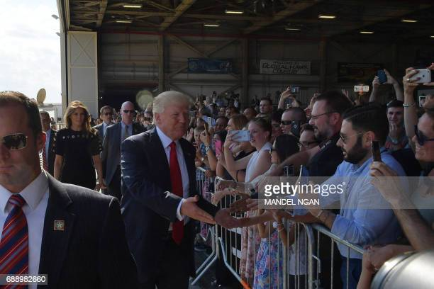 US President Donald Trump and US First Lady Melania Trump greet US military personnel and families at Naval Air Station Sigonella after G7 summit of...