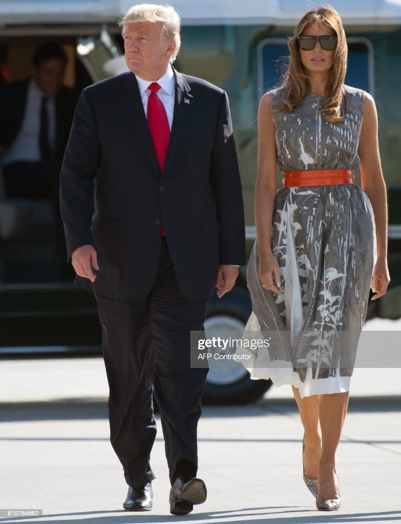 US President Donald Trump (L) and US First Lady Melania Trump make their way to board Airforce One after the G20 Summit in Hamburg, Germany, July 8, 2017. Leaders of the world's top economies gather from July 7 to 8, 2017 in Germany for likely the stormiest G20 summit in years, with disagreements ranging from wars to climate change and global trade. /
