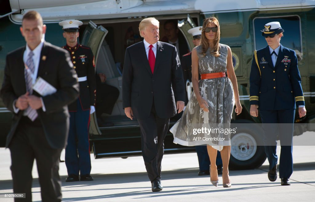 President Donald Trump and US First Lady Melania Trump make their way from Marine One to board Airforce One after the G20 Summit in Hamburg, Germany, July 8, 2017. Leaders of the world's top economies gather from July 7 to 8, 2017 in Germany for likely the stormiest G20 summit in years, with disagreements ranging from wars to climate change and global trade. /