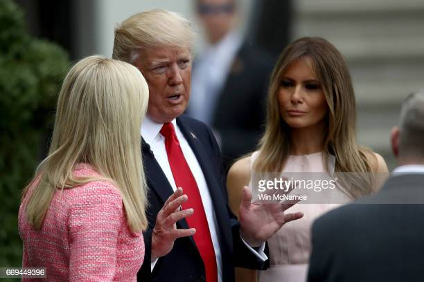 S President Donald Trump and US first lady Melania Trump speak with a reporter during the 139th Easter Egg Roll on the South Lawn of the White House...