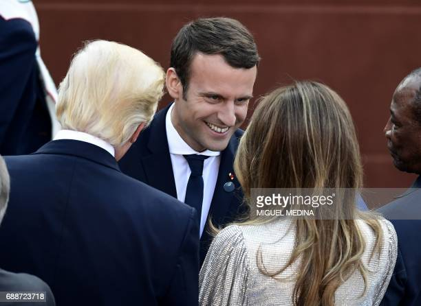 US President Donald Trump and US First Lady Melania Trump speak with French President Emmanuel Macron as they arrive for a concert of La Scala...