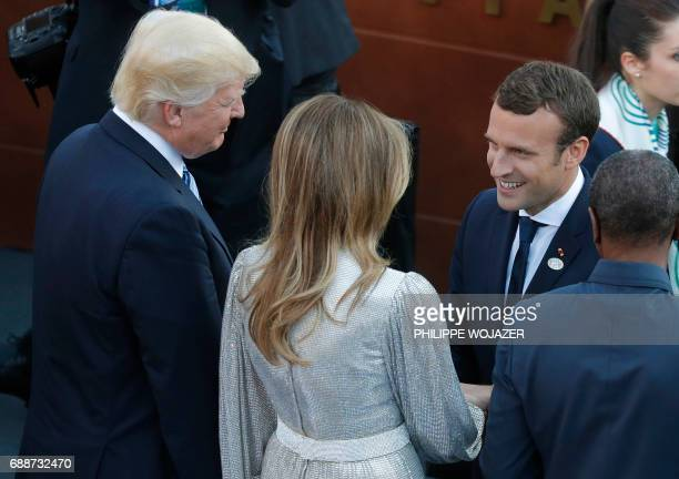 US President Donald Trump and US First Lady Melania Trump speak with French President Emmanuel Macron as they arrive for a concert of the La Scala...