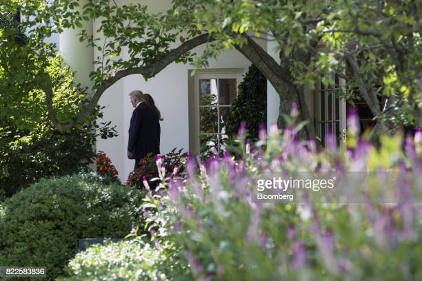 US President Donald Trump and US First Lady Melania Trump walk out of the White House to board Marine One on the South Lawn in Washington DC US on...