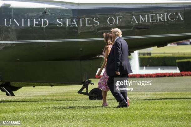 US President Donald Trump and US First Lady Melania Trump walk to board Marine One on the South Lawn of the White House in Washington DC US on...