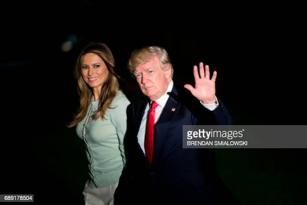 US President Donald Trump and US first lady Melania Trump walk to the residence of the White House from Marine One on the South Lawn May 27 2017 in...