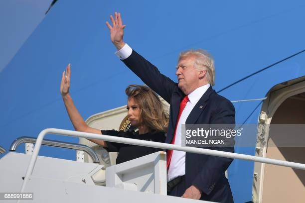 US President Donald Trump and US First Lady Melania Trump wave as they board Air Force One before departing from US military Naval Air Station...