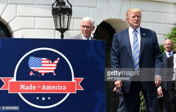 President Donald Trump and Vice President Mike Pence are seen on the South Portico during a Made in America product showcase event at the White House...