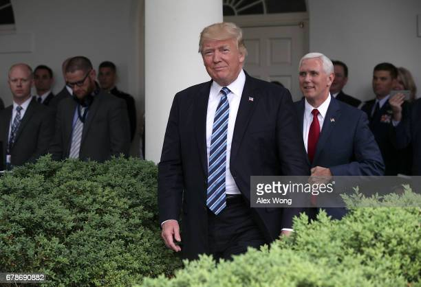 S President Donald Trump and Vice President Mike Pence arrive at a Rose Garden event May 4 2017 at the White House in Washington DC The House has...