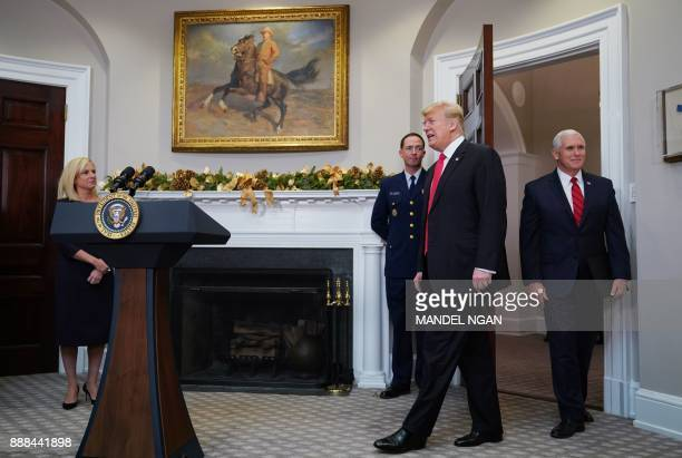 US President Donald Trump and Vice President Mike Pence arrive in the Roosevelt Room for the swearingin ceremony for Homeland Security Secretary...