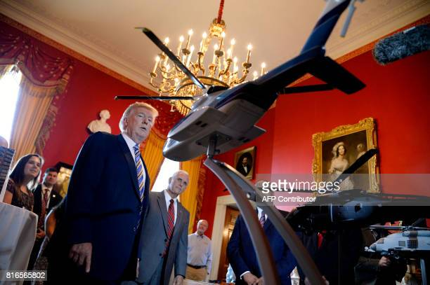 President Donald Trump and Vice President Mike Pence examine USmade products from all 50 states including helicopter models from Sikorsky in the Red...