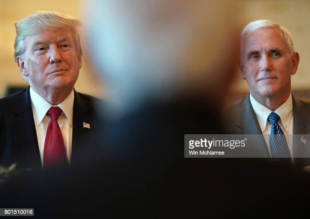 S President Donald Trump and Vice President Mike Pence listen as Indian Prime Minister Narendra Modi offers remarks before dinner at the White House...