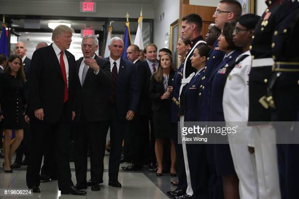 S President Donald Trump and Vice President Mike Pence listen to Secretary of Defense Jim Mattis as Trump about to greet service members after a...