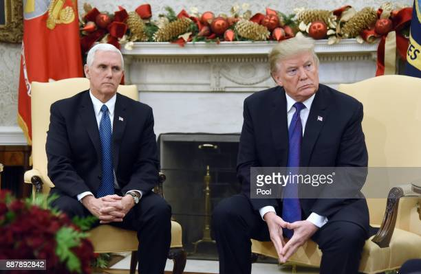 US President Donald Trump and Vice President Mike Pence looks on during a meeting with Congressional leadership including House Minority Leader Rep...