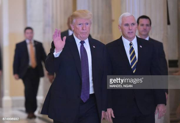 US President Donald Trump and Vice President Mike Pence make their from out of the Capitol after meeting with House Republicans on November 16 2017 /...