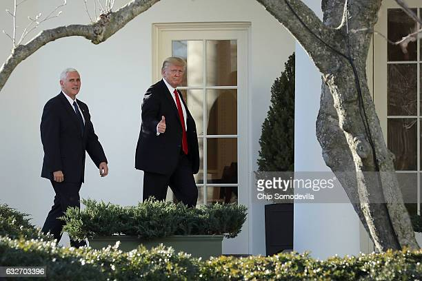 US President Donald Trump and Vice President Mike Pence return to the White House after visiting the Department of Homeland Security January 25 2017...