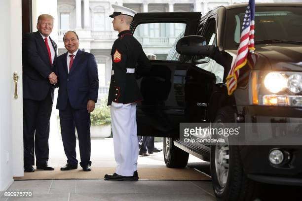 S President Donald Trump and Vietnamese Prime Minister Nguyen Xuan Phuc shake hands after meeting at the White House May 31 2017 in Washington DC...