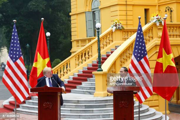 US President Donald Trump and Vietnam's President Tran Dai Quang attend a news conference at the Presidential Palace in Hanoi on November 12 2017...