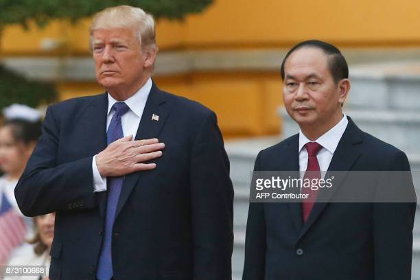 US President Donald Trump and Vietnam's President Tran Dai Quang attend a welcoming ceremony at the Presidential Palace in Hanoi in Hanoi on November...