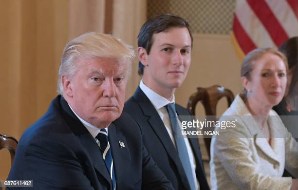 US President Donald Trump and White House senior advisor Jared Kushner take part in a bilateral meeting with Italy's Prime Minister Paolo Gentiloni...