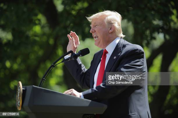 S President Donald Trump announces his decision for the United States to pull out of the Paris climate agreement in the Rose Garden at the White...