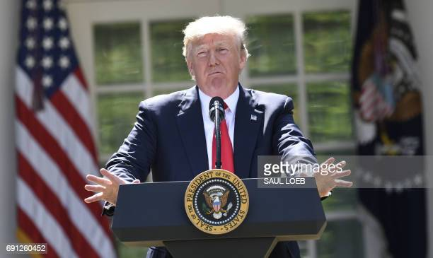 US President Donald Trump announces his decision on the Paris Climate Accords in the Rose Garden of the White House in Washington DC on June 1 2017 /...