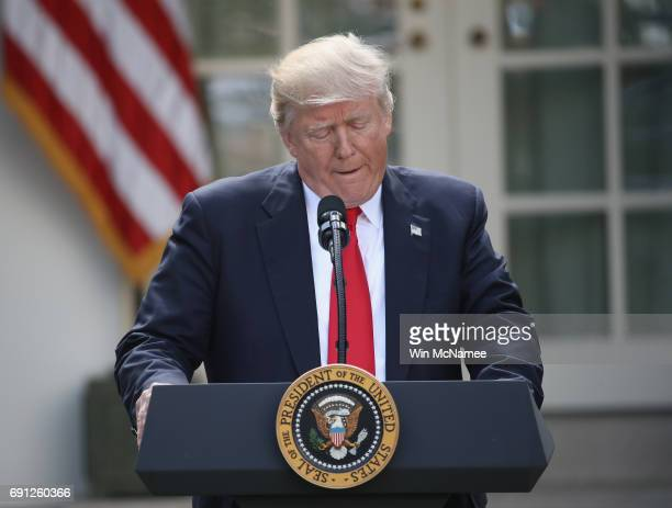 S President Donald Trump announces his decision regarding the United States' participation in the Paris climate agreement in the Rose Garden at the...