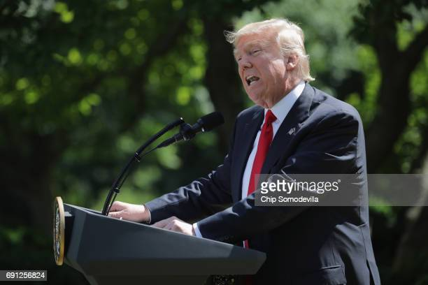 S President Donald Trump announces his decision to pull the United States out of the Paris climate agreement in the Rose Garden at the White House...
