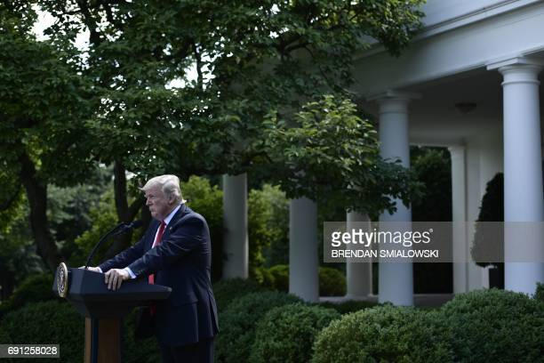 US President Donald Trump announces his decision to withdraw the US from the Paris Climate Accords in the Rose Garden of the White House in...