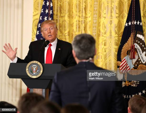 S President Donald Trump answers a question from CNN's Jim Acosta during a news conference announcing Alexander Acosta as the new Labor Secretary...