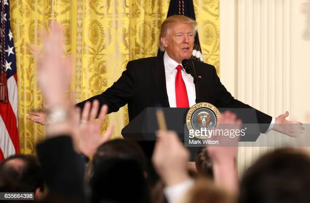 S President Donald Trump answers questions from the media during a news conference announcing Alexander Acosta as the new Labor Secretary nominee in...