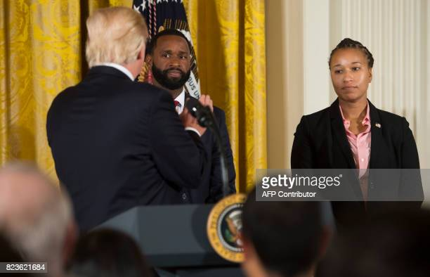 US President Donald Trump applauds US Capitol Police Officers Crystal Griner and David Bailey prior to presenting them with Medal of Valor to the...