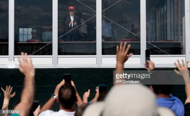 President Donald Trump applauds wellwishers during the 72nd US Women's Open Golf Championship at Trump National Golf Course in Bedminister New Jersey...