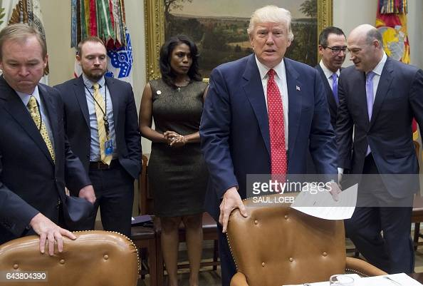 US President Donald Trump arrives alongside Office of Management and Budget Director Mick Mulvaney during a meeting about the federal budget in the...