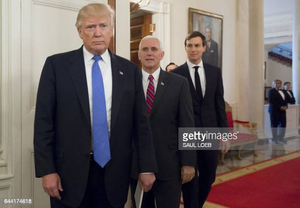 US President Donald Trump arrives alongside Vice President Mike Pence and White House Senior Advisor Jared Kushner during a meeting with...