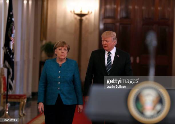 S President Donald Trump arrives at a joint press conference with German Chancellor Angela Merkel in the East Room of the White House on March 17...