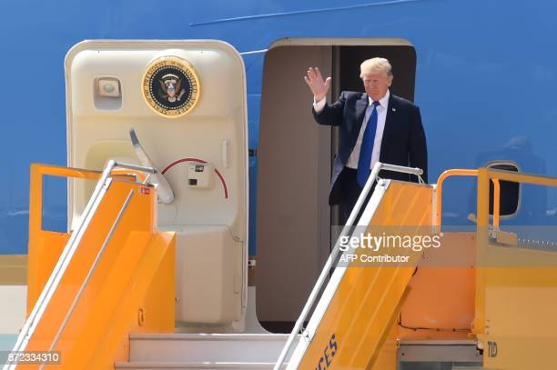 US President Donald Trump arrives at the international airport ahead of the AsiaPacific Economic Cooperation Summit in the central Vietnamese city of...
