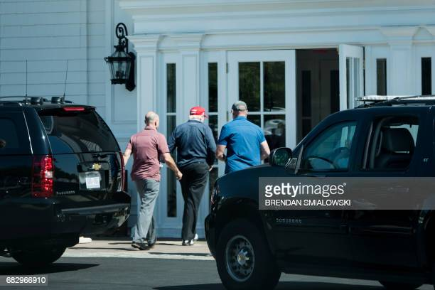US President Donald Trump arrives at the Trump National Golf Club May 14 2017 in Sterling Virginia / AFP PHOTO / Brendan Smialowski