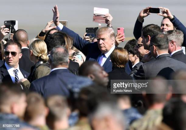 US President Donald Trump arrives at US Yokota Air Base in the suburbs of Tokyo on Nov 5 for his first visit to Japan since taking office in January...