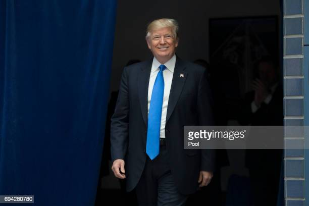 President Donald Trump arrives before delivering remarks on infrastructure investment and deregulation at the Department of Transportation on June 9...